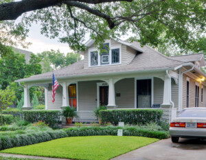 Bungalow style house that has a full front porch along with several column bases, has a dormer on the roof.