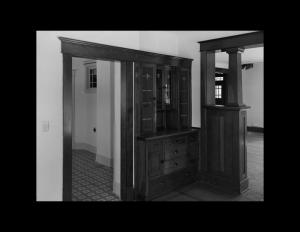 Interior of home showcasing bungalow style door trim, hardwood flooring, and window mouldings.
