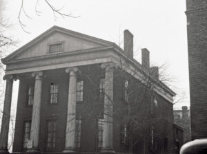 Campbell-Whittlesey house with big columns, side steps to entrance, brick chimney, exterior cornice mouldings, and window mouldings and casings.