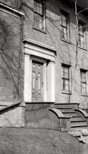 Campbell-Whittlesey house doorway with column mouldings, panel molds, casing, and steps to entrance.