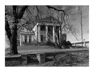 Hervey Ely house features large columns, window mouldings, and brick chimneys.