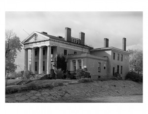 Hervey Ely house features large columns, steps leading to entrance, window mouldings, and brick chimneys.