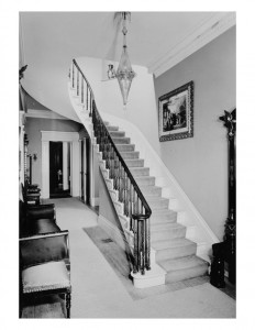 Interior of Hervey Ely house featuring door mouldings, staircase with balustrade, and interior cornice mouldings.