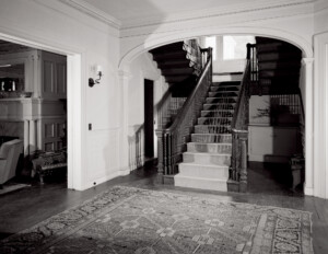Interior of a colonial revival style home showcasing interior cornices and door mouldings.
