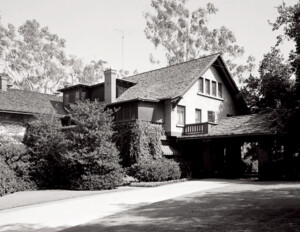 Craftsman style house that features a gable dormer, side balcony, window mouldings, and overhanging roof.