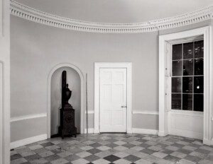 Oval federal style room featuring door mouldings, interior cornice, and window mouldings.