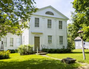 Greek Revival Western Reserve style building with window mouldings, and door mouldings.