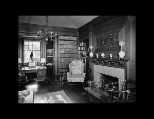 Interior of colonial revival style home featuring interior cornice, window mouldings, fireplace mouldings, and rectangle wall mouldings.