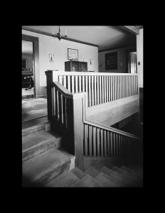 Interior of a craftsman style house that has door mouldings with wall cornice.