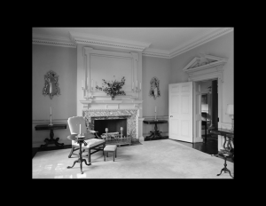 Interior of geogrian style room showcasing interior wall cornice, door mouldings, and fireplace mouldings.