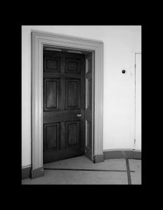 Interior of federal style building showcasing door mouldings.