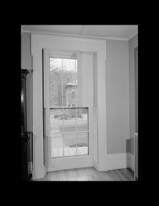 Interior of greek revival style house featuring lower wall mouldings, and window mouldings.