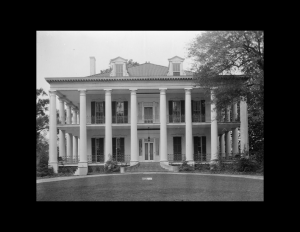 Greek revival southern plantation style featuring shingle siding, window mouldings, and door mouldings.