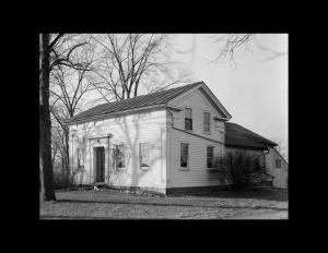 Greek Revival Western Reserve style building with door mouldings and cornice mouldings.