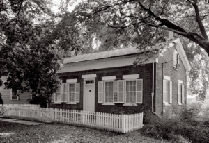 Birthplace of Thomas Edison which features picket fence and windows with shutters.