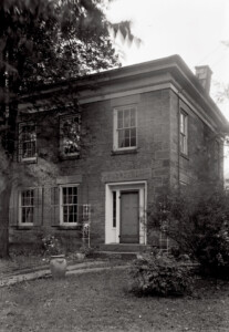 The Bronson house features all brick exterior, first floor windows with shutters, second story plain windows, door mouldings, cornice mouldings.