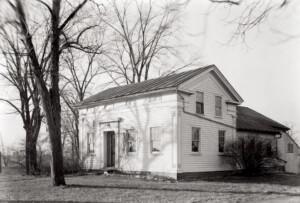 Clark Pratt Kernery house exterior featuring shingle siding, door casing mouldings, window casing mouldings, and cornice mouldings.