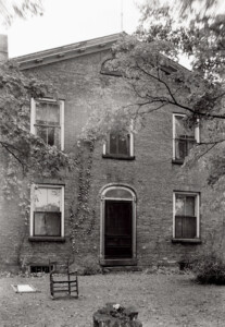 Exterior of Cordon Taylor House featuring window mouldings, and doorway mouldings.