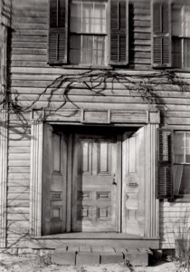 Exterior of Dirlam Allen House showcasing the main doorway featuring door panel molds, and steps to entrance.