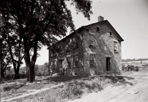 Exterior of Fosdick house featuring all brick walls, window casing mouldings, steps to entrance, door mouldings, and two chimneys.