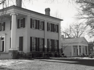 Exterior of Frederick Kinsman Office featuring columns with a covered porch, and shingle siding.