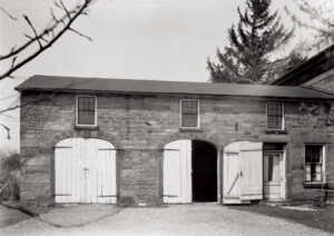 Exterior of Hurst House featuring all brick walls, window mouldings, and oval wooden doors.