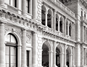 Close up of an italian renaissance style castle featuring balconies, columns, cornice mouldings, and window mouldings.