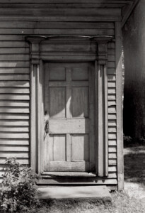 Exterior of Joshua R Giddings law office front door featuring panel molds, and step to entrance.