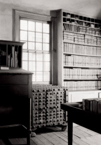 Interior of Joshua R Giddings law office featuring window casing, and library book storage.