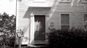 Exterior of Chester Moffett House door featuring shingle siding.