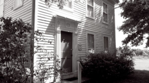 Exterior of Chester Moffett House door featuring window mouldings.