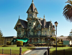 Victorian style castle with steep roof, overhanging roof, window mouldings, and door mouldings.
