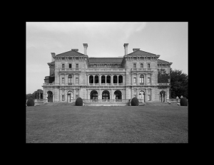 Italian renaissance style castle with low pitched hipped roof, columns, and window mouldings.