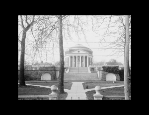 Large dome with neoclassical style, that showcases a large entrance with steps, columns, and cornice mouldings followed by a circular building behind.