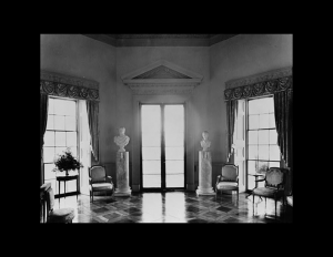 Interior of neoclassical building with door mouldings and cornice mouldings.