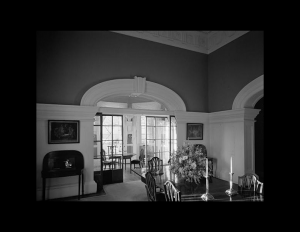 Interior of neoclassical building with door mouldings, cornice mouldings, window mouldings, and neoclassical room ornaments.