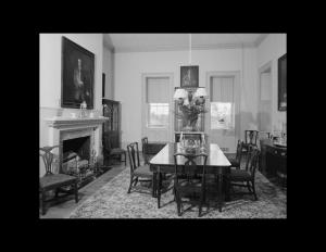 Whitewashed palladian style room featuring cornice mouldings, hardwood flooring, and door mouldings.