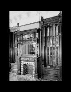 Interior of Victorian style room with fireplace mouldings, and cabinetry mouldings.