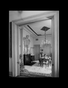 Interior of Victorian style room with door mouldings, and cornice mouldings.