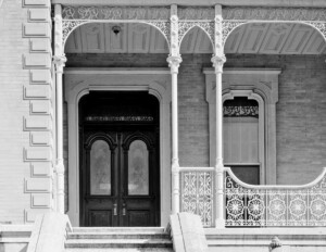 Victorian style house featuring a covered porch with columns, door mouldings and window mouldings.