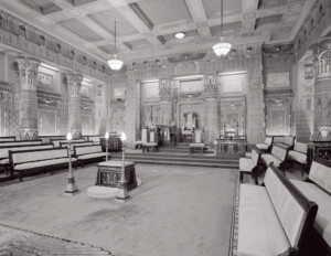 Interior of an egyptian revival style building featuring columns, wall mouldings, and cornice mouldings.