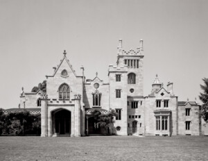 Gothic Revival style castle with pointed arches, large stained glass windows, ribbed vaults, and ornate decoration.