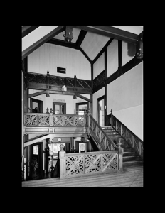 Hardwood staircase leading upstairs in a stick style house featuring ceiling mouldings, and doorway mouldings.