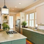 A modern kitchen that uses crown moulding traditionally and as cabinet accents to add depth to the woodwork