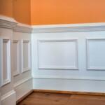 A white chair rail accenting a warm hued wall